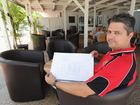 Beach House Hotel manager Paul Robins in the newly revamped beer garden with plans for the hotel's rebuild.