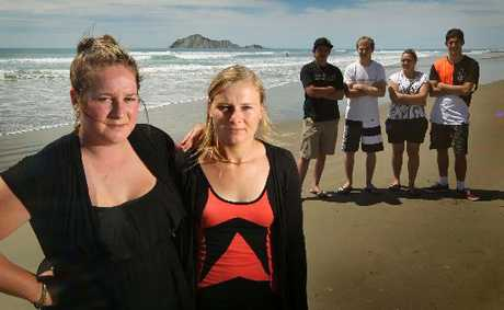 LIFE SAVERS: Laura Donovan (left) and registered nurse Lynda Coldicutt, with their friends Taare Black (back, left), Shay Wall, Larissa Hamlin and David Kapaor, pulled a collapsed, drunken man from the surf at Waimarama Beach at about 1.30am yesterday.