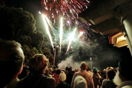 MIDNIGHT MERRIMENT: Partygoers watch the Napier Sound Shell fireworks signal 2013 at the stroke of midnight.