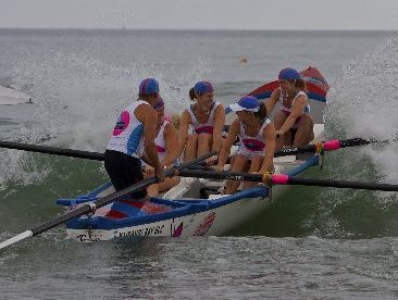 HOT FAVOURITES: The Mairangi Bay women's surf boat crew competing in Whangamata last year.