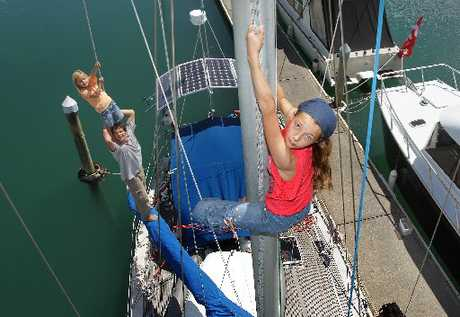HIGH SEAS: Loeva Rabilier, 12, climbs the mast while 4-year-old Ondja stands on her father Franck's shoulders, on board their yacht La Loupiote.