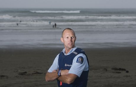Whakatane's Constable Dean Oswald saved three swimmers from a rip at Ohope Beach on Wednesday night