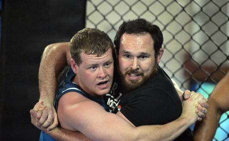 Part of the Sea Eagles pre season training involved an intense wrestling session. Matt Bowd and Brenton Stonier.