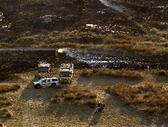 FLAMES CONTAINED: Smoke rises after firefighters extinguish a 1.5-hectare grass fire at Ocean Beach about 5am yesterday. They remained at the scene to dampen down.