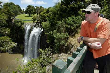 BLACK MARK: Andy Tuvey at the Whangarei Falls. The Hatea River above the falls is one of four swimming spots declared unsafe to swim.