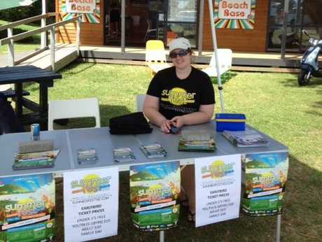 Sarah Martin selling Summerfest tickets outside the Beach Base on the Mount Main Beach.