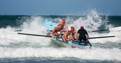 Omanu's under-19 surf boat crew on their way to victory in Whangamata.