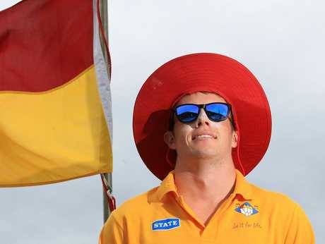Mount Maunganui Surf Life Saving Club head lifeguard James Roy shows how best to slip, slop, and slap as casualties of the season&#39;s hot sun begin to tally up.