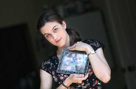 Rotorua's Natalie Piesse is heading to Carterton for a memorial service on Monday for her friend Alexis Still and the 10 other people who were killed in the ballooning tragedy a year ago. Miss Piesse is pictured holding a photograph of Miss Still.