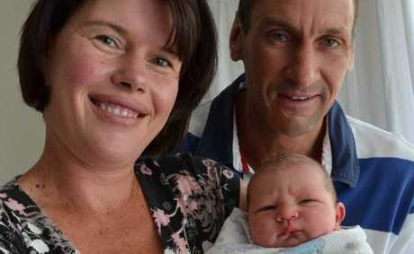 THIRD-TIME PARENTS: Theresa and Jon Penfold with their new addition, Samuel.
