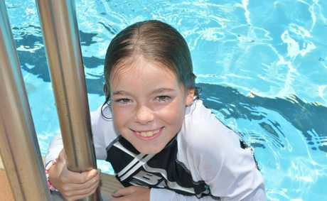 Jainda Champney cools off at the pool.