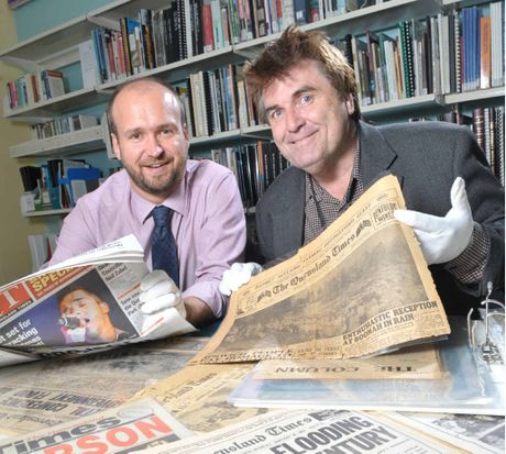 LOOKING BACK: Cr David Pahlke (right) with The Queensland Times editor Stuart Sherwin at the Ipswich City Library looking at old QT newspapers.