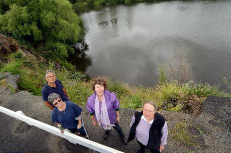 LONG WAY DOWN: Papaiti residents Charles Jackson, Jenny Jackson, Melinda Hatherly-Jones and Pascale Merten say something needs to be done about a dropout on their road.PHOTO/ STUART MUNRO