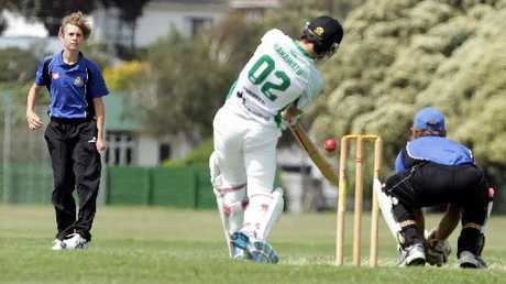 TOMORROW TODAY: Wanganui U16 bowler Dylan Martin sends down a delivery to Manawatu U16 batsman George Larsen at Springvale Park, watched by wicketkeeper Brett Cameron. PHOTO / STUART MUNRO