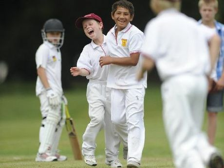 Got 'im! Connor Booth and Dre Thompson celebrate a wicket for Taradale Under-10 team during their unbeaten run at the Riverbend Camp Cricket tournament at Frimley Park, Hastings, last summer.