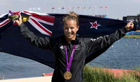 Ohope's Lisa Carrington shows off her Olympic gold medal won in the women's K1 200m final.