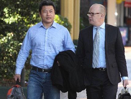 "Hui ""Leo"" Gao (left) walks to the Rotorua Courthouse with his lawyer, Ron Mansfield, on the day he was sentenced to four years and seven months' jail."