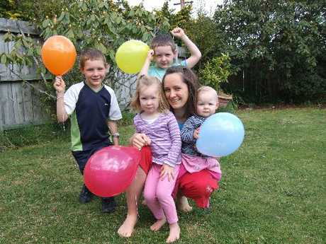 PARTY TIME: When it comes to birthdays it's all about home-made fun for the Peake family of (clockwise from left) Joshua, 7, Scott, 5, mum Katrina, Deborah, 1, and Elizabeth, 3, with favourite food chosen by the birthday child and a decorated cake.