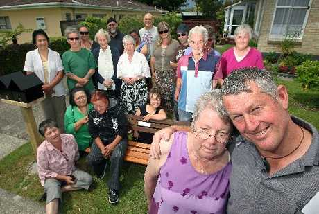 Residents of Phillip St and friends unveil a memorial bench for murder victim Michelle Hoffman-Tamm. Pictured is Michelle's sister Jan Donlan (left front) and Robert van den Akker, along with friends and neighbours.