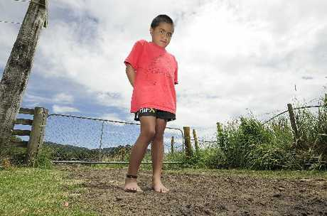 LUCKY: Te Puke 6-year-old Raymond Junior Kapene stands on the spot where he fell off the back of a 4WD driven by his grandfather. Raymond was run over by a trailer that was being towed but escaped remarkably unscathed.