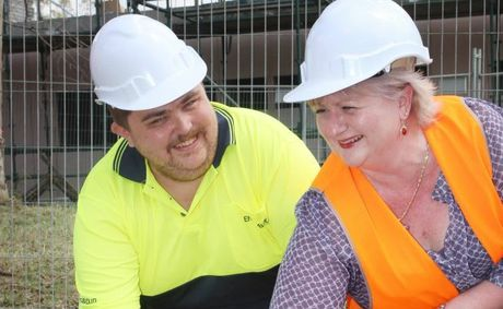 Endeavour employee Daniel Rivers and Yeerongpilly customer service manager Carol Dickfos laying their hand prints in the wet cement which marks the beginning of the construction of their new site. Photo: Inga Williams / The Satellite