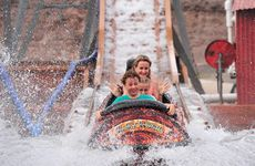 Jaiden Brooks, 11, from the Gold Coast rides up front through the spray on the Aussie World Log Flume with Zackary Edwards, 5, Alyssia Brooks, 9, and Chris Donnelly getting a soaking behind. Photo: Iain Curry / Sunshine Coast Daily