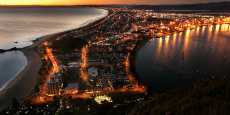 The spectacular view looking down over the main beach at Mt Maunganui at dawn. The Mount is one of the top summer holiday destinations in New Zealand.