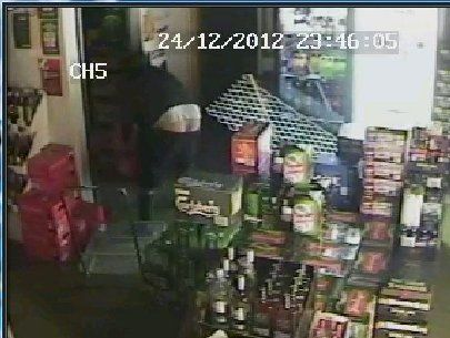 BUMMER: The CCTV image of the man who became known as the Buttcrack Bandit after an alleged burglary of Houhora Liquor Centre on Christmas Eve that has since gone viral.