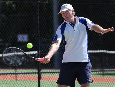 RUNNER UP: Gate Pa Tennis Club president Mike Callard in action in the singles final.
