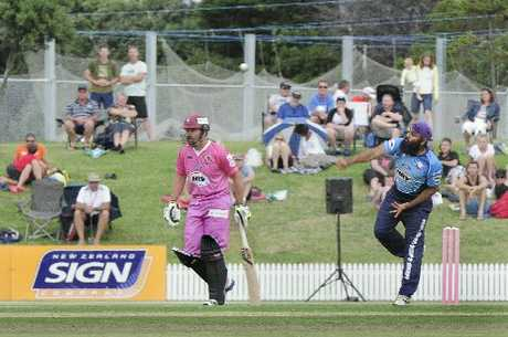 TIGHT BOWLING: Bhupinder Singh was one of the Auckland Aces' best at Bay Oval. Batting is Northern Knights' Brad Wilson.