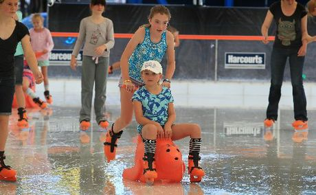 FUN: Pascale Bowie, 7, and sister Marseille, 10, on the ice.