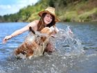 Ellen McLaughlin and her border collie Rusty cool off.