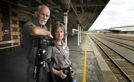 Photographers Mal and Sue McIlwraith will no longer use the tracks in front of Toowoomba Railway Station as a shoot location after being warned by police.
