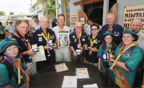 Scouting dignitaries and junior scouts pose with the medal collection presented to museum curator John Meyers (centre) at the Military and Colonial Museum.