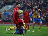 LIVERPOOL manager Brendan Rodgers said Luis Suarez&#39;s matchwinner against non-league Mansfield Town should have been ruled out for handball.