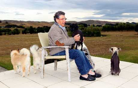 Sir Paul Holmes with his beloved dogs at Mana Estate at the beginning of January. FILE