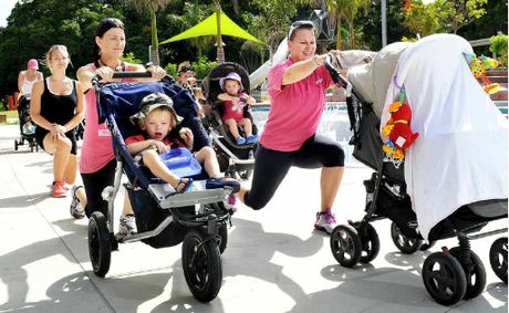 Personal trainer Belle Stockwell (right) takes a group of mums through a fitness session.