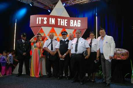 ON STAGE: Whanganui Maori Wardens were the koha recipients from Saturday night's It's in the Bag with Stacey Morrison and Pio Terei. From left are August Tyson, Morrison, Doug Broughton, Ambrose Marion, Barry Harris (rear), Te Reo Hemi, Celia Boyd and Terei.