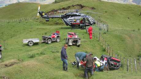 CRASH: Emergency services at the scene of a quad bike accident near Te Haroto yesterday morning. An injured man was flown to Hawke's Bay Hospital. PHOTO/SUPPLIED