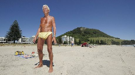 BEACH BODY: Colin Francis&#39; gold shorts and dark tan have made him a well-recognised figure on Mount Maunganui Main Beach.