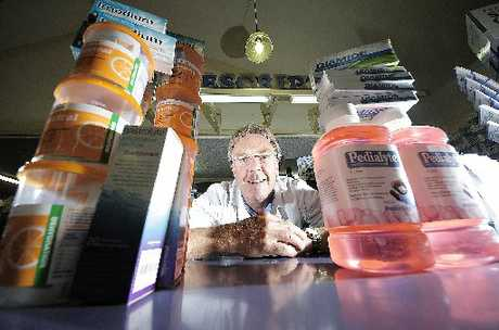 BUSY: Bethlehem Pharmacy's Mark Arundel offers gastro relief products for sufferers.