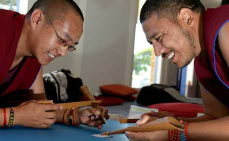 Phunysok Lhundup and Tenpa Gyamtso working on their sand art.
