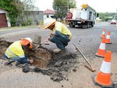 Council workers fixing a burst pipe at Tiger Street, West Ipswich on Tuesday. Photo: Sarah Harvey / The Queensland Times