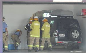 Firefighters at the scene of a crash where a four-wheel drive punched through the wall of a home in Toogoom.