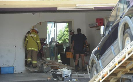 Emergency services officers investigate an incident in which a four-wheel drive ploughed into a holiday rental house in Toogoom.
