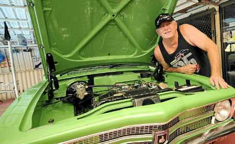 NICE DONK: West Ballina's Roy Short shows off the engine of his 1971 LC Torana before this Sunday's Show and Shine in Ballina.
