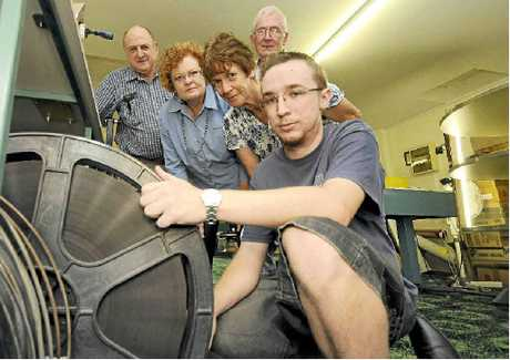 ON A DEADLINE: Volunteer board members of the Kyogle Community Cinema (from left) James Crawter, Kay Crawter, Dianne Bells and Peter Baxter with projectionist Michael Knight, prepare reels of 35mm film for screening on Friday night.