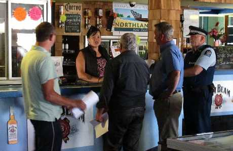 SHUT UP SHOP: Council officers and police serve the court order on Kaikohe Hotel duty manager Louella Webster.