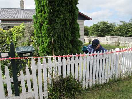 Police examine a Waihi house as part of their investigation into the murder of Murray Wilkinson. An 18-year-old Waihi man has been charged with his murder.