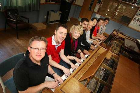 SIXTEEN HANDS OF OPERA: New Zealand Opera School pianists, from left, Greg Neil, Travis Baker, Iola Shelley, Flavio Villani, Bruce Greenfield, Somi Kim, David Kelly and (intern) Edward Guffney.PHOTO / BEVAN CONLEY